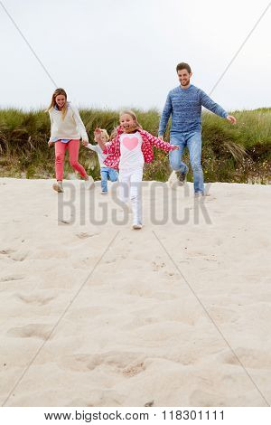 Family Having Fun On Beach Together
