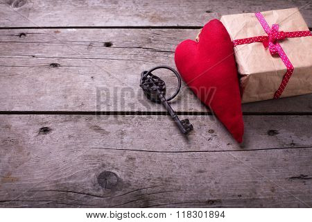 Red Decorative  Heart, Vintage Key And Gift Box  On Aged Wooden Background.
