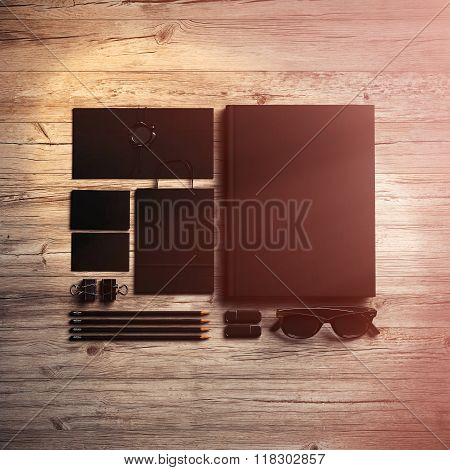 Set of branding elements on the wood background. Sunlight effects. 3d render