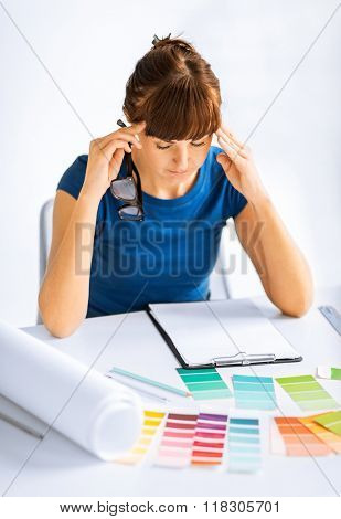 interior design and renovation concept - stressed interior designer