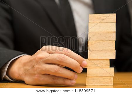 Alternative Risk Concept. Businessman Choosing The Wood Block
