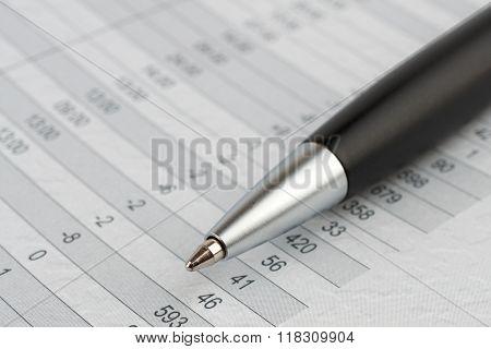 Black Ballpoint Pen On A Sheet.