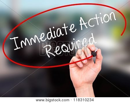 Man Hand Writing Immediate Action Required With Black Marker On Visual Screen