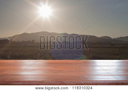Old Empty Wooden Table Top With Sunrise And Field Background