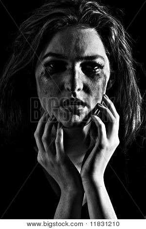A woman with fear in her eyes