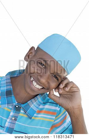 Twelve-year-old boy wearing a blue hat, isolated