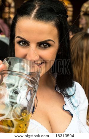 Girl drinking beer at Oktoberfest