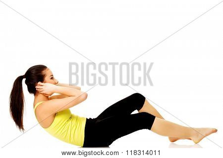 Woman exercising and doing a crunch.