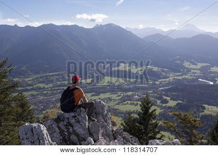 Man Is Sitting On A Rock