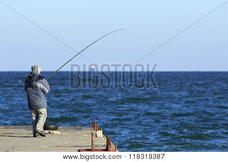 Fisher At The Pier