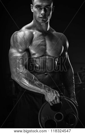 Muscular Man Workout With Barbell Plate
