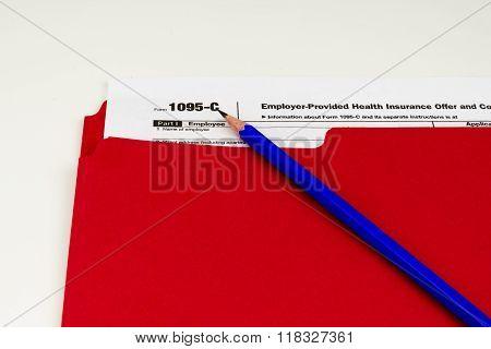 Tax Form 1095-c on Light Background
