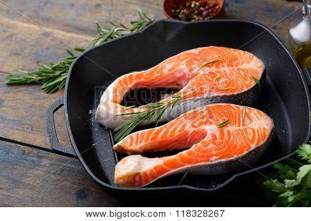 Steak Raw Salmon On A Griddle Pan