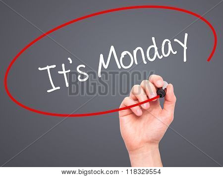 Man Hand Writing It's Monday With Black Marker On Visual Screen