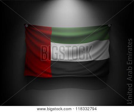 waving flag United Arab Emirates on a dark wall