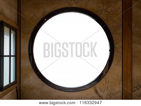 Isolated Japanese Round window Over White  NIKKO JAPAN - NOVEMBER 16 2015: Tamozawa Imperial Villa first built in Tokyo in 1632. It was deconstructed and moved to the present location in Nikko in 1898