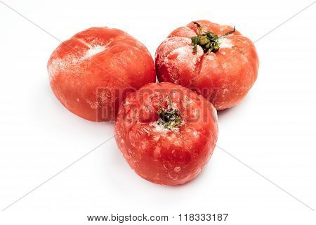 Frozen Tomatoes Isolated On White Background