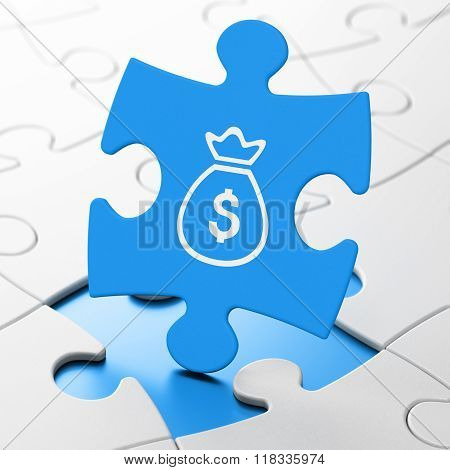 Money concept: Money Bag on puzzle background