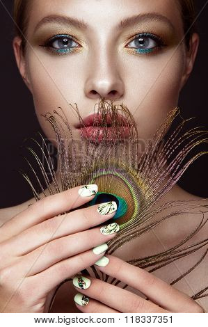 Beautiful Girl With Bright Makeup, Manicure Design And Peacock Feather On Her Face. Art Nails.