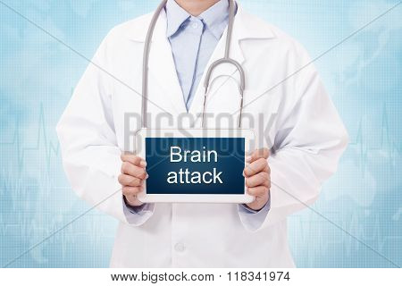 Doctor holding a tablet pc with brain attack sign on blue background