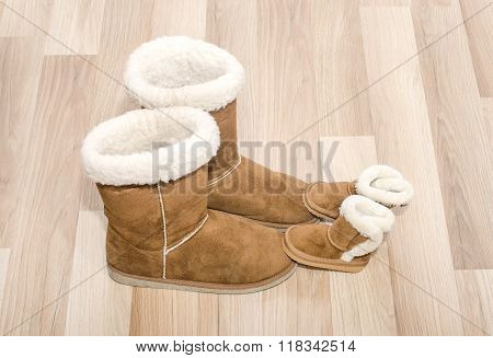 Pair Of Winter Woman Boots And Similar Pair Of Kid Boots.