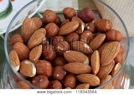 Almonds And Hazelnuts In A Glass Container