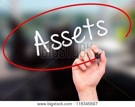 Man Hand Writing Assets With Black Marker On Visual Screen