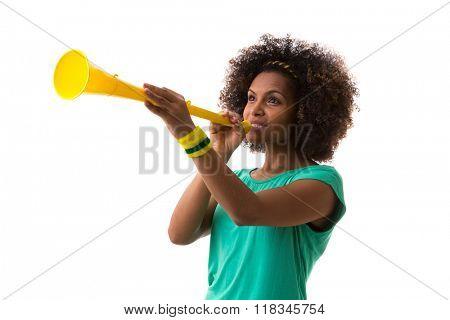 Brazilian woman blowing by vuvuzela on white background