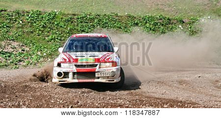 BAKAL, RUSSIA - AUGUST 8: Andrey Yadov's Mitsubishi Lancer Evolution (No. 12) competes at the annual Rally Southern Ural on August 8, 2008 in Bakal, Satka district, Chelyabinsk region, Russia.