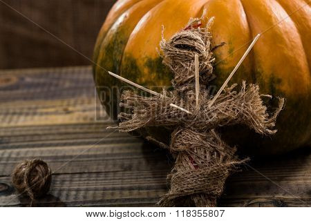 Sackcloth Doll Near Pumpkin