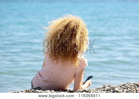 Young Woman On Pebble Beach