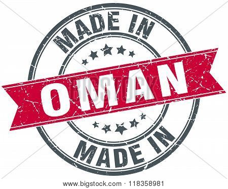 made in Oman red round vintage stamp