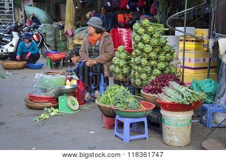 Woman selling artichokes at the Central market of Dalat. Vietnam
