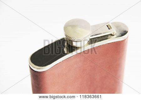 Brown flask for alcohol drinks isolated on white