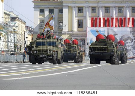 A convoy of rocket launchers coming out on Palace square. Rehearsal of parade in honor of Victory Da