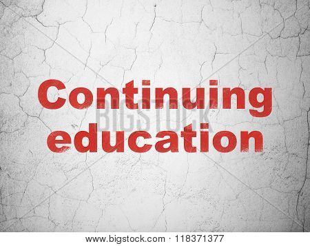 Learning concept: Continuing Education on wall background