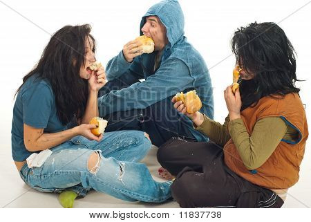 Three Beggars Sharing A Bread