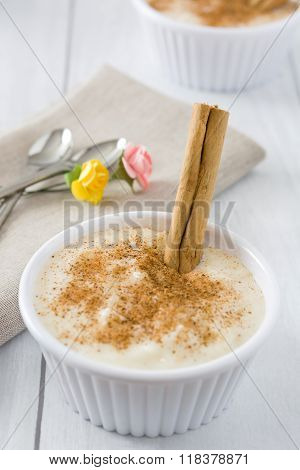 Rice pudding on white wood