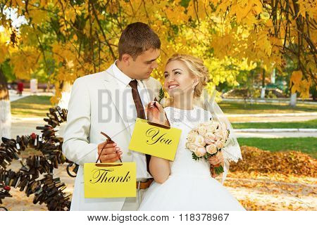 Couple With Signs With The Words