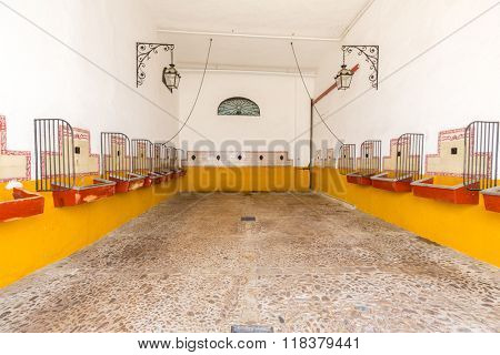 empty bull stable in bullfight arena, plaza de toros, Sevilla, Spain