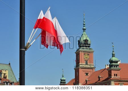 Third of May is Constitution Day in Poland. City decorated with flags. Royal Castle in Warsaw Old Town and flags around that day.