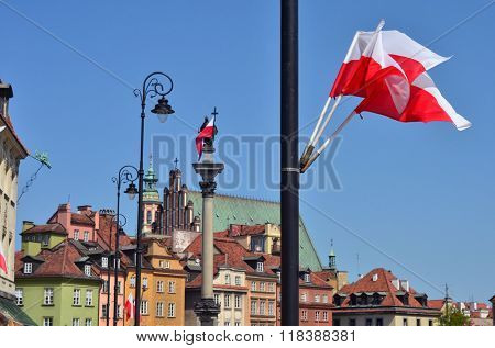 Third of May Constitution Day bank holiday in Poland. Warsaw Old Town decorated with polish flags. Royal Castle square.