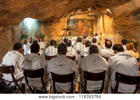 JERUSALEM, ISRAEL - JULY 13, 2014: Franciscan monks during mass in Grotto of Gethsemane - chapel located in cave near Tomb of the Virgin Mary. This is the place where Judas Iscariot betrayed Jesus.