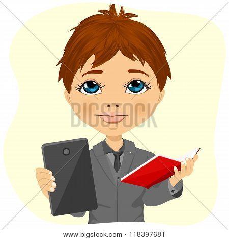 little schoolboy choosing between tablet and books
