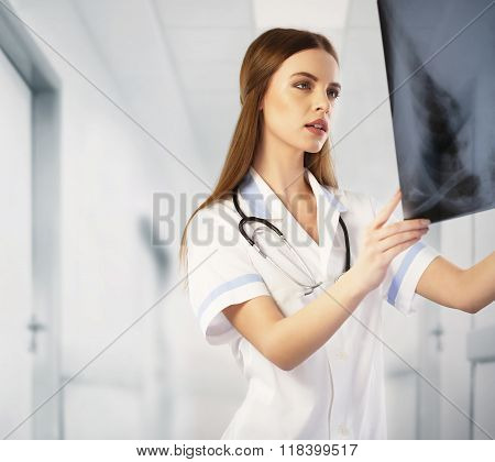 Radiologist looking at an X-ray. Doctor at work
