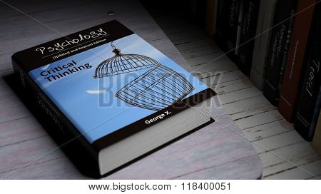 Hardcover book on Psychology with illustration on cover, on wooden surface.
