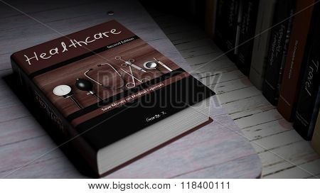 Hardcover book on Healthcare with illustration on cover, on wooden surface.