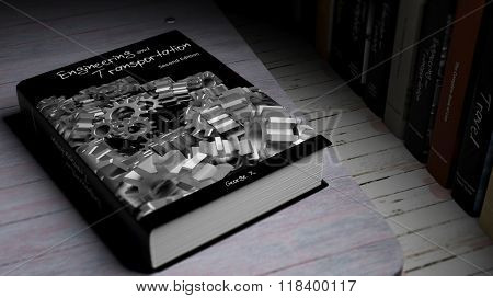 Hardcover book on Engineering and Transportation with illustration on cover, on wooden surface.