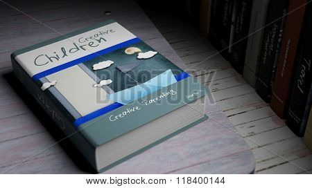 Hardcover book on Creative Children with illustration on cover, on wooden surface.