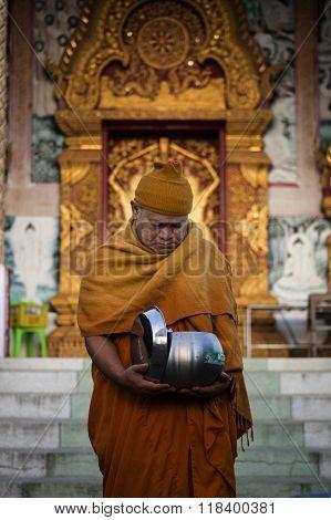Thai Monk recieving morning alms